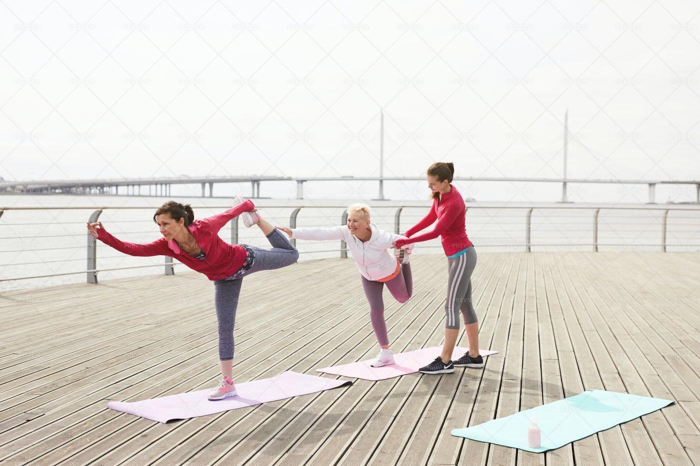 Yoga Class On Pier: Stock Photos