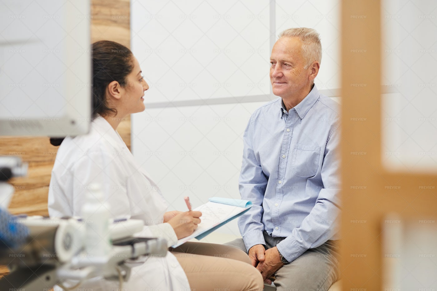 Middle-Eastern Doctor Checking...: Stock Photos