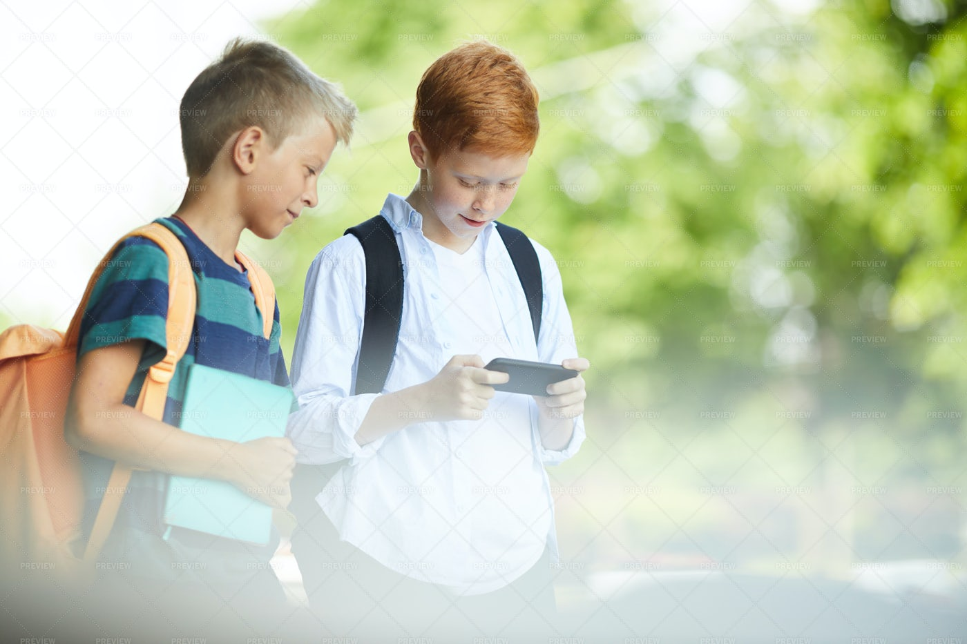 Kids Playing With Phone: Stock Photos