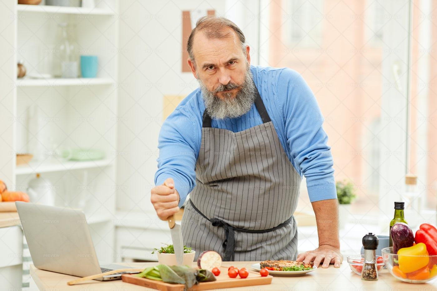 Tough Senior Man Cooking: Stock Photos