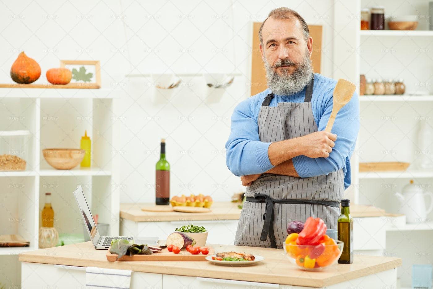Senior Man Posing In Kitchen: Stock Photos