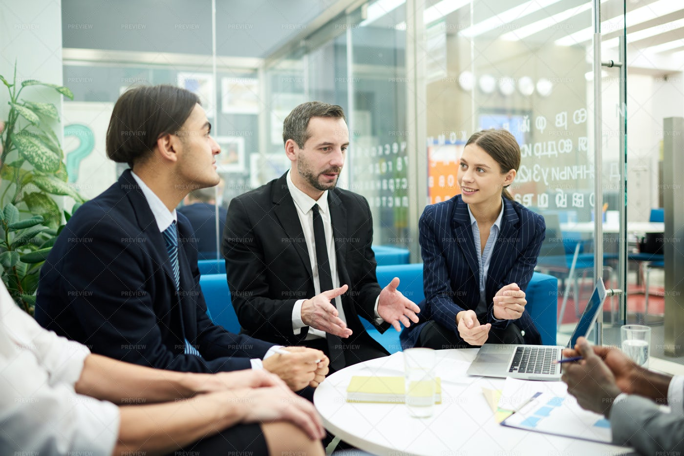 Businesspeople Meeting In Office: Stock Photos