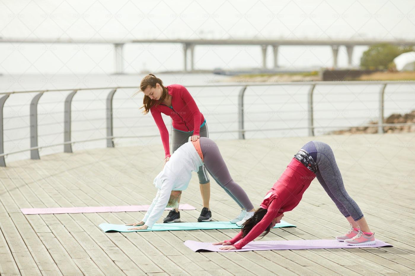 Morning Yoga Class Outdoors: Stock Photos