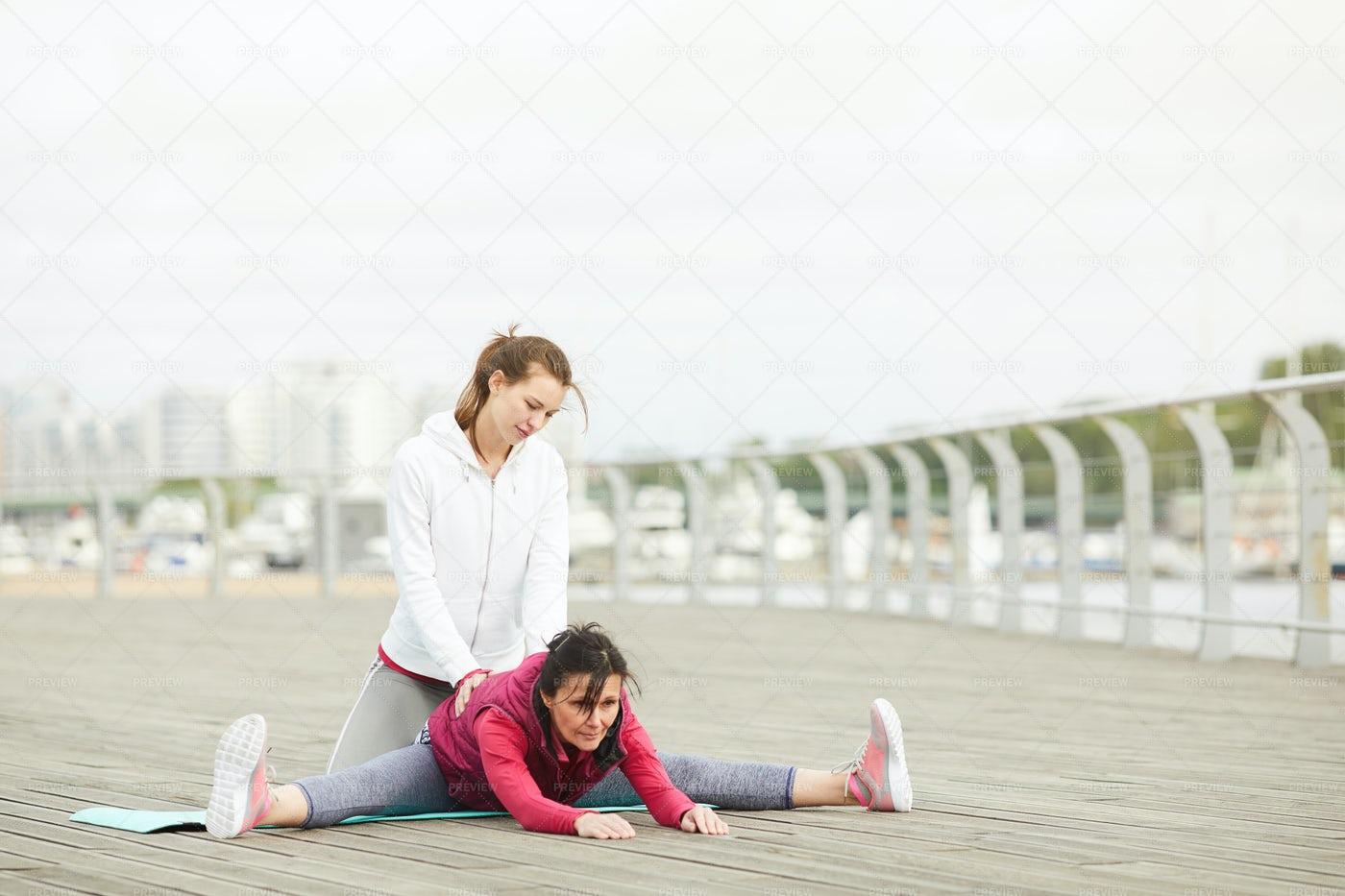 Mature Woman Stretching Legs: Stock Photos