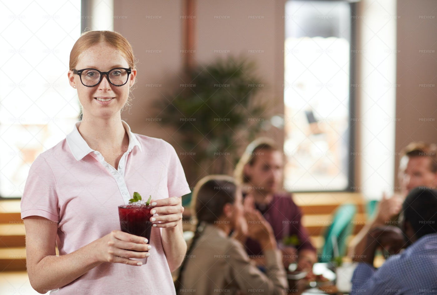 Young Woman Holding Cocktail Drink: Stock Photos
