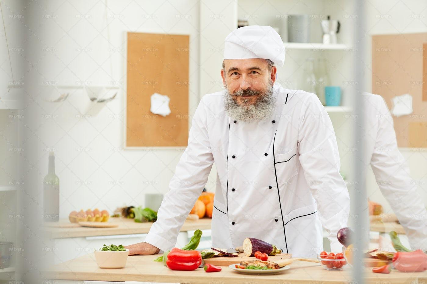 Senior Chef Posing In Kitchen: Stock Photos