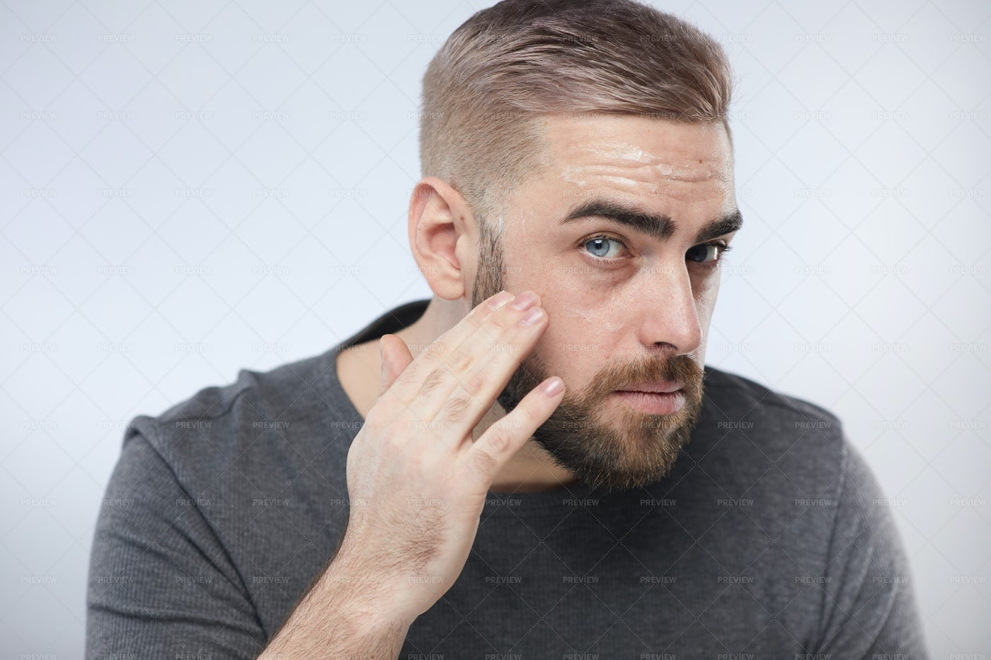 Confident Man Using Skincare...: Stock Photos
