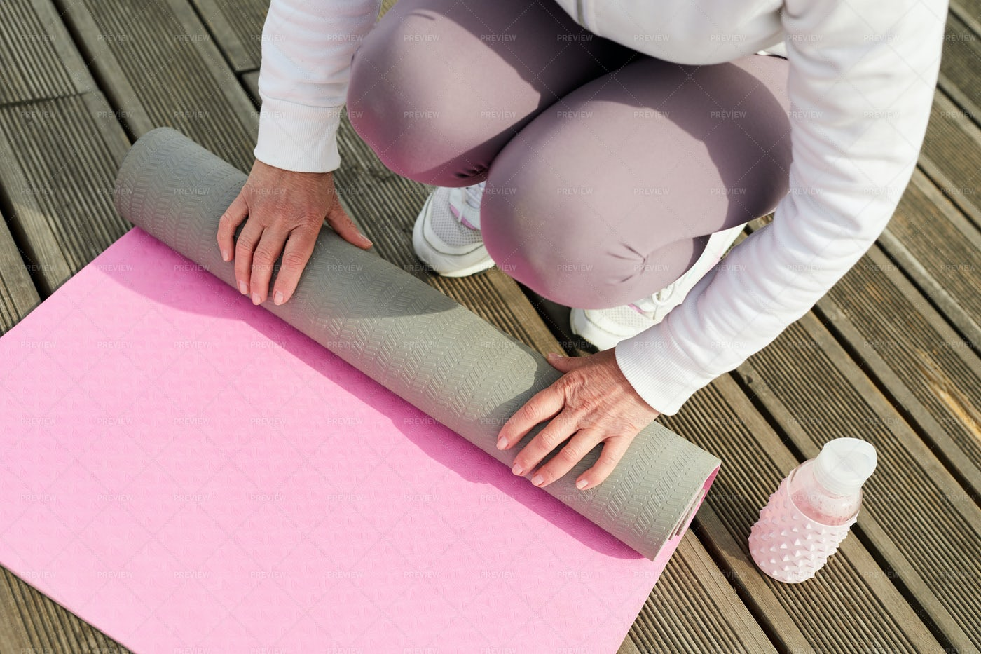 Woman Unrolling Yoga Mat: Stock Photos