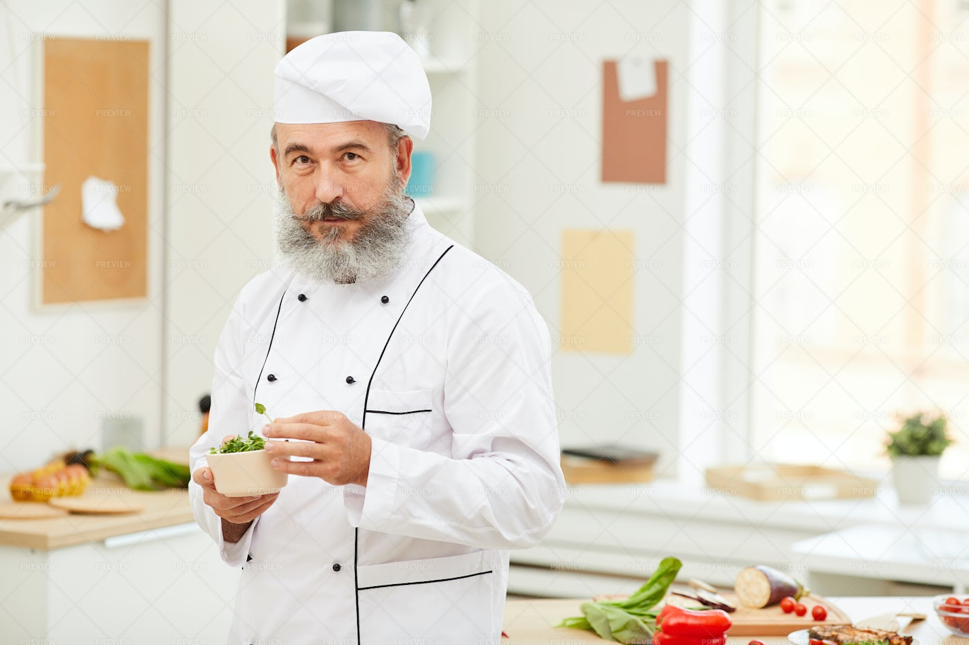 Professional Chef Posing In Kitchen: Stock Photos