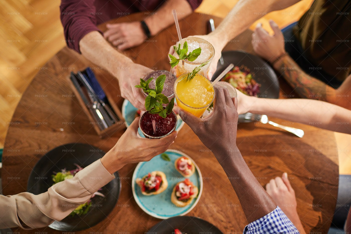 Friends Toasting With Drinks: Stock Photos