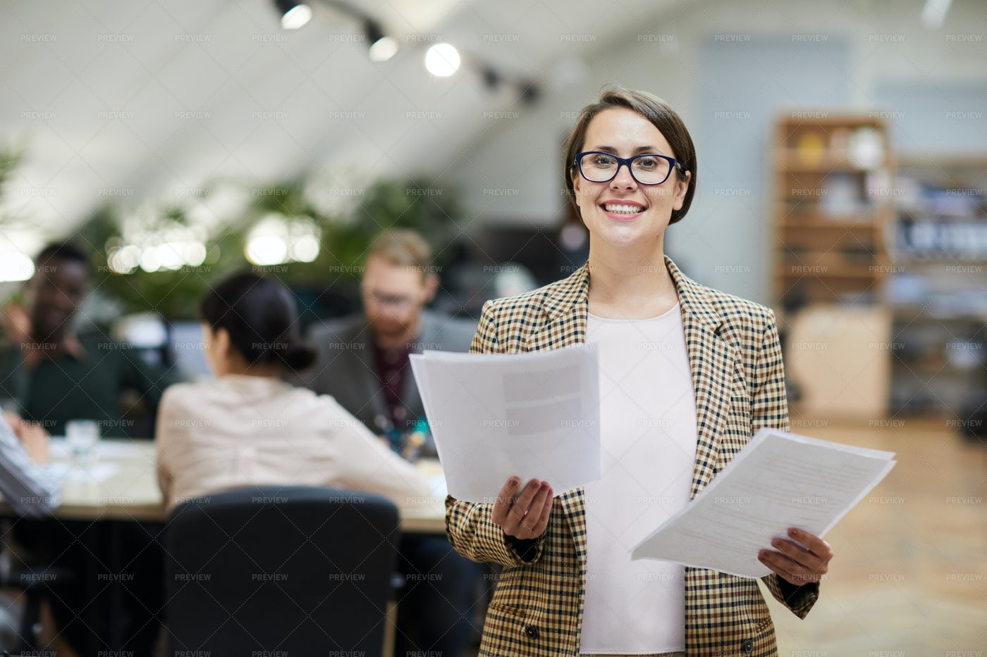 Smiling Businesswoman Posing In...: Stock Photos