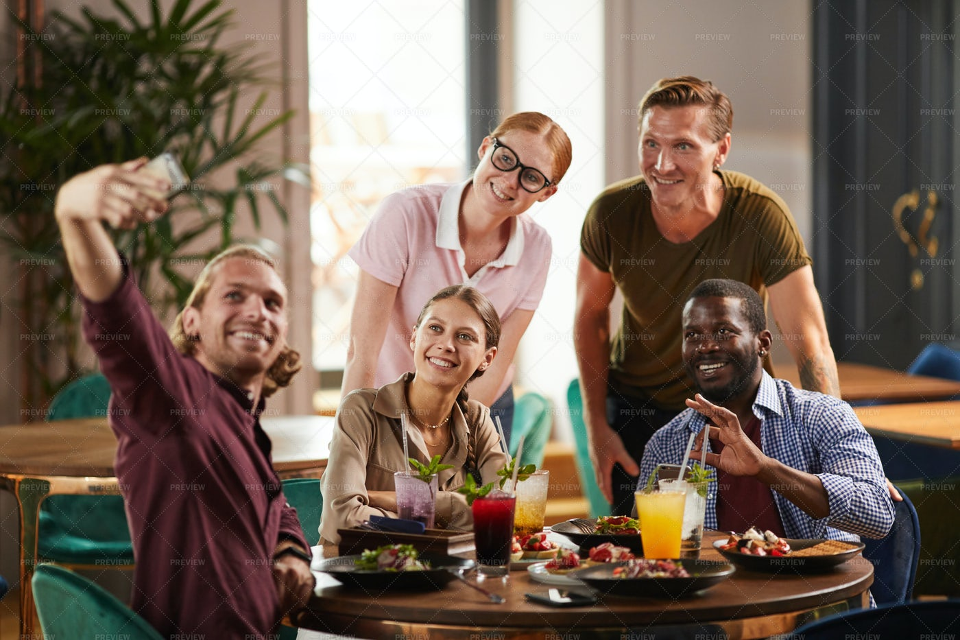 Friends Taking Selfie At Lunch: Stock Photos