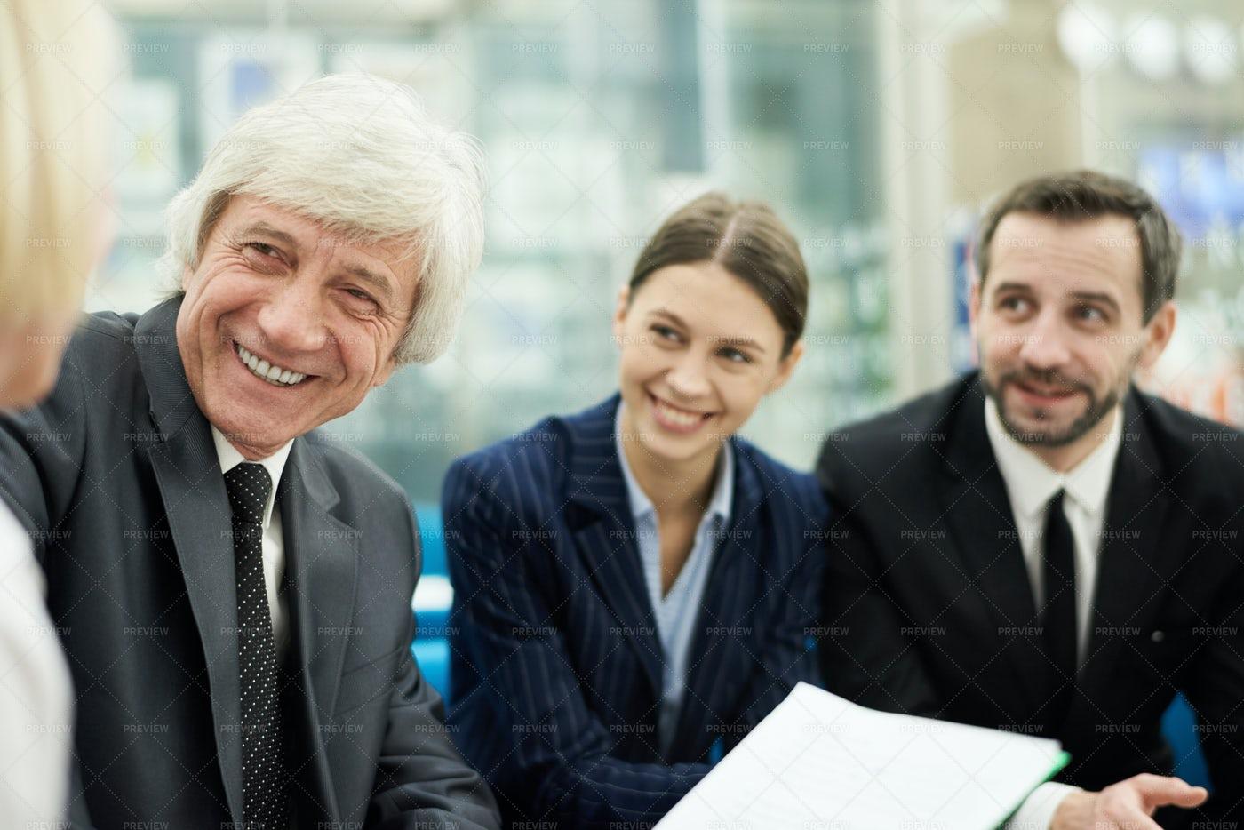 Senior Boss Meeting With Employees: Stock Photos