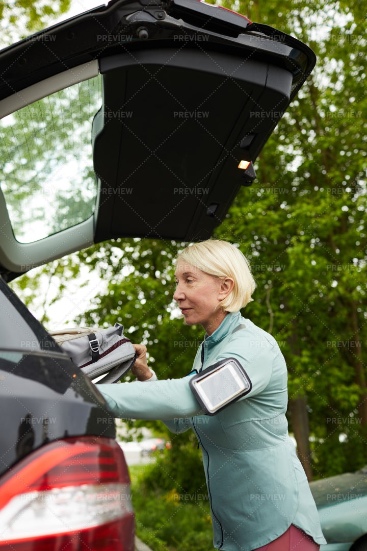 Sportswoman By Car: Stock Photos