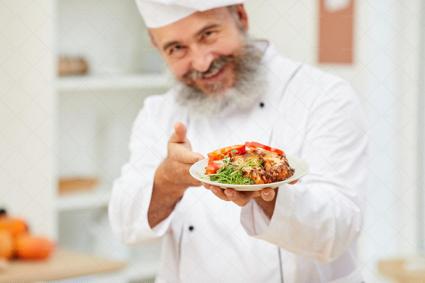 Senior Chef Presenting Steak: Stock Photos