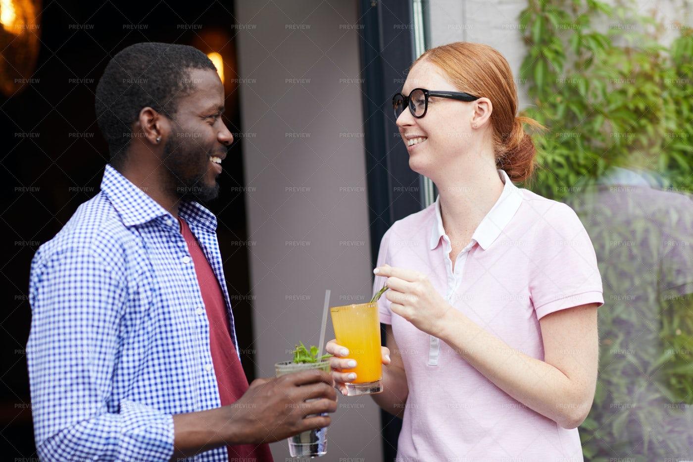People Enjoying Drinks Outdoors: Stock Photos