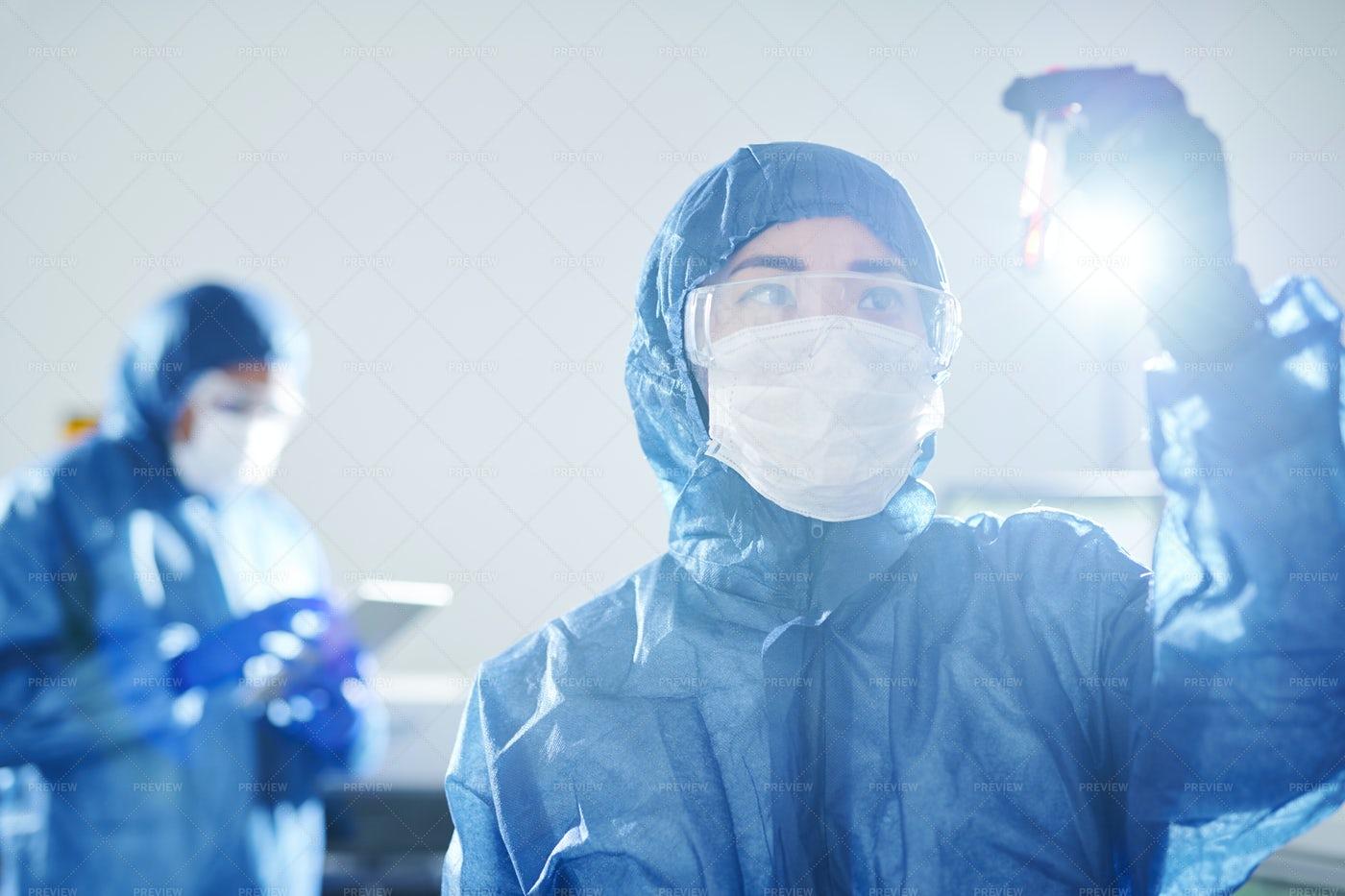 Virologist Researching Antibody In...: Stock Photos
