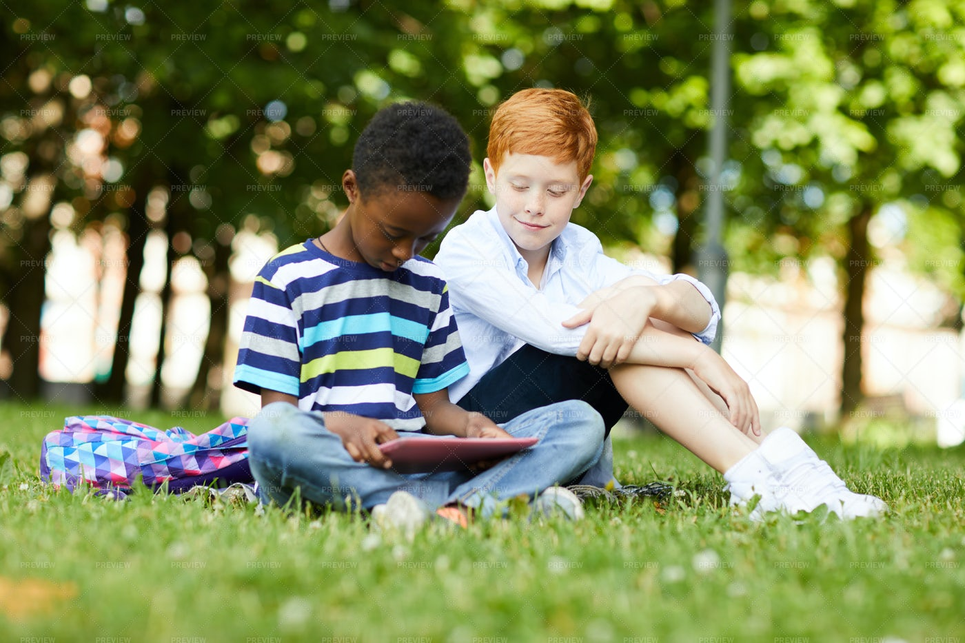 Schoolboy Playing With Tablet: Stock Photos