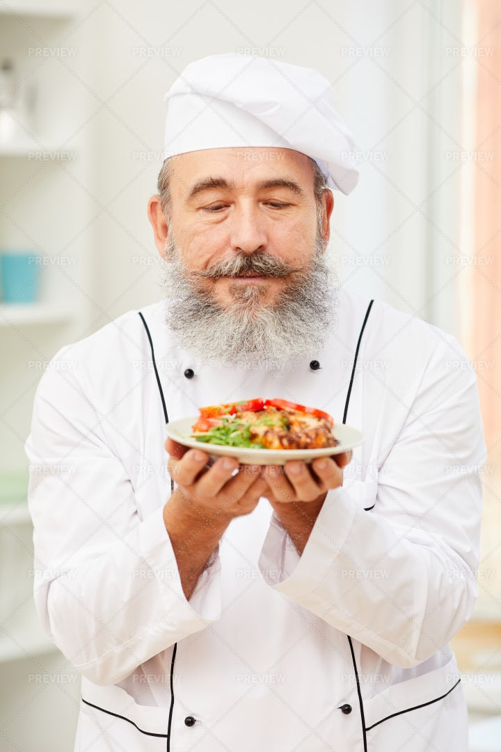 Charismatic Chef Presenting...: Stock Photos