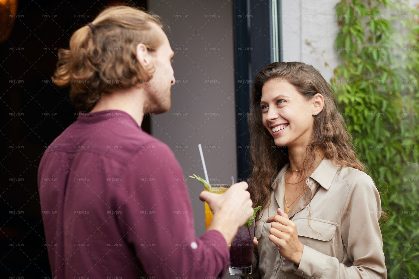 Young Couple Chatting Outdoors By...: Stock Photos