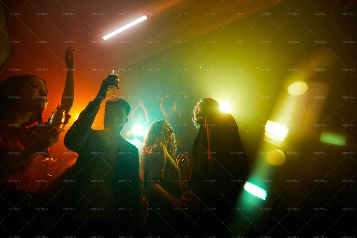 People Dancing In Disco Lights: Stock Photos