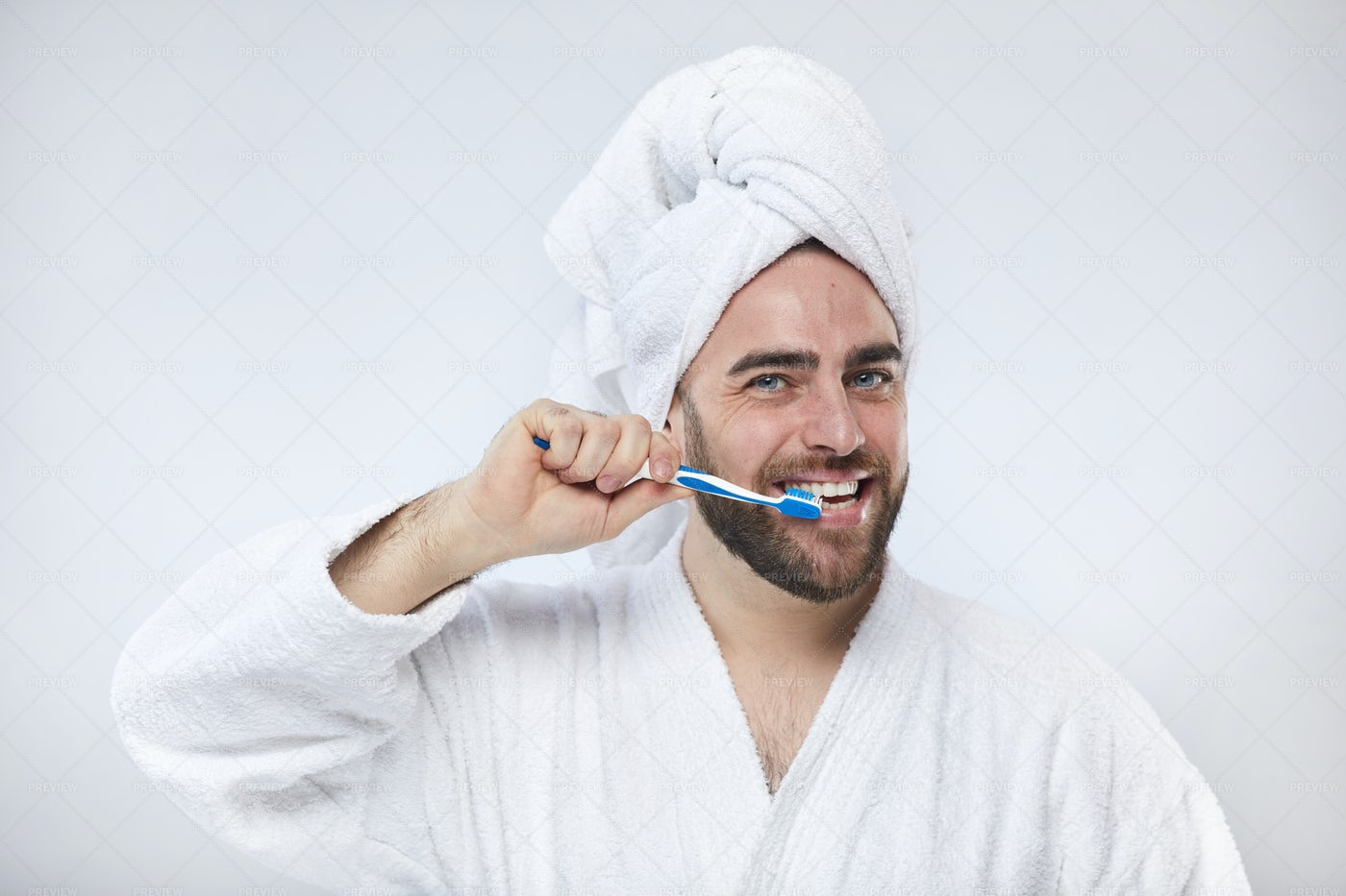 Happy Young Man Brushing Teeth: Stock Photos
