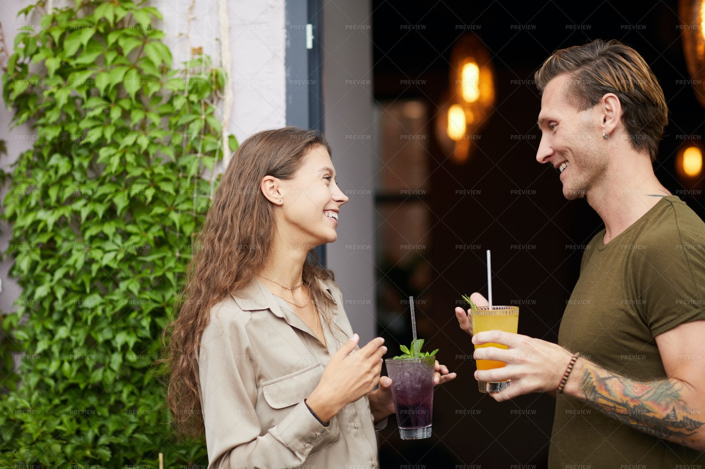 Friends Chatting Outdoors By Cafe: Stock Photos