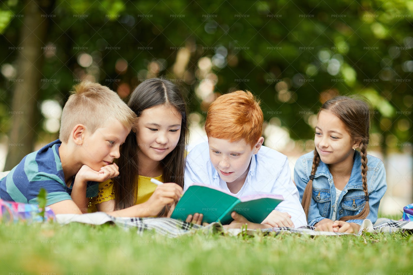 Studying Together In Park: Stock Photos