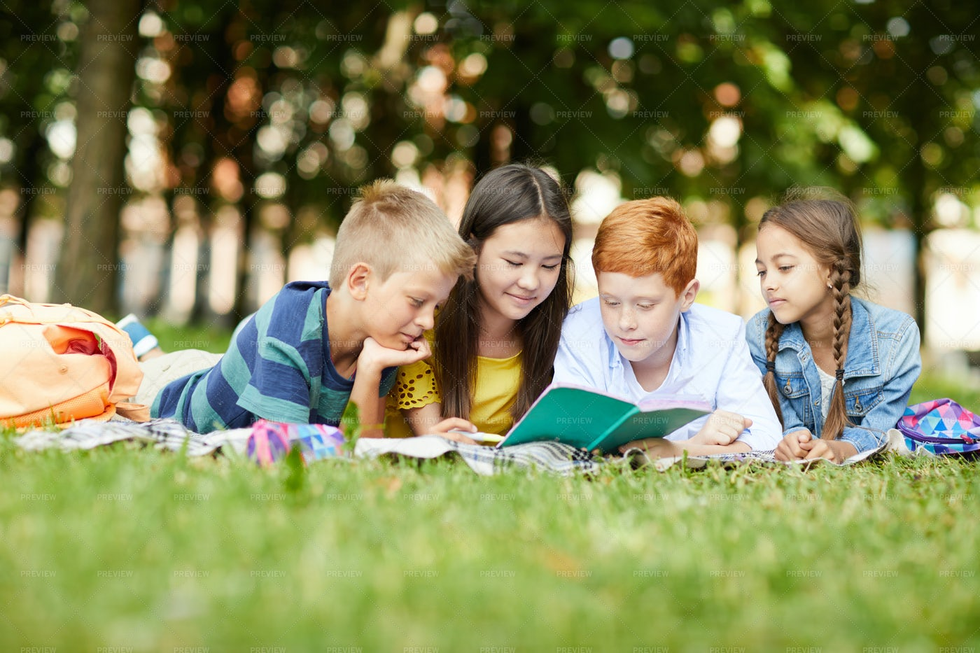 Reading Together In Park: Stock Photos