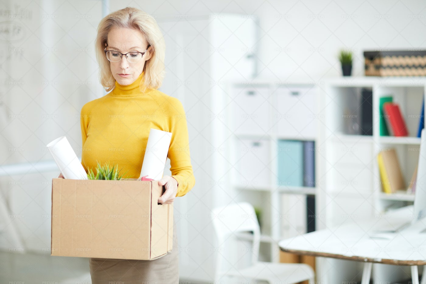 Mature Businesswoman Leaving Work: Stock Photos