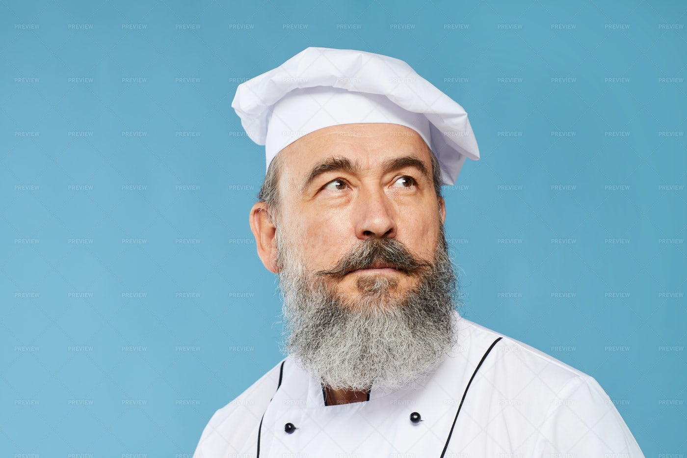 Daydreaming Senior Chef On Blue: Stock Photos