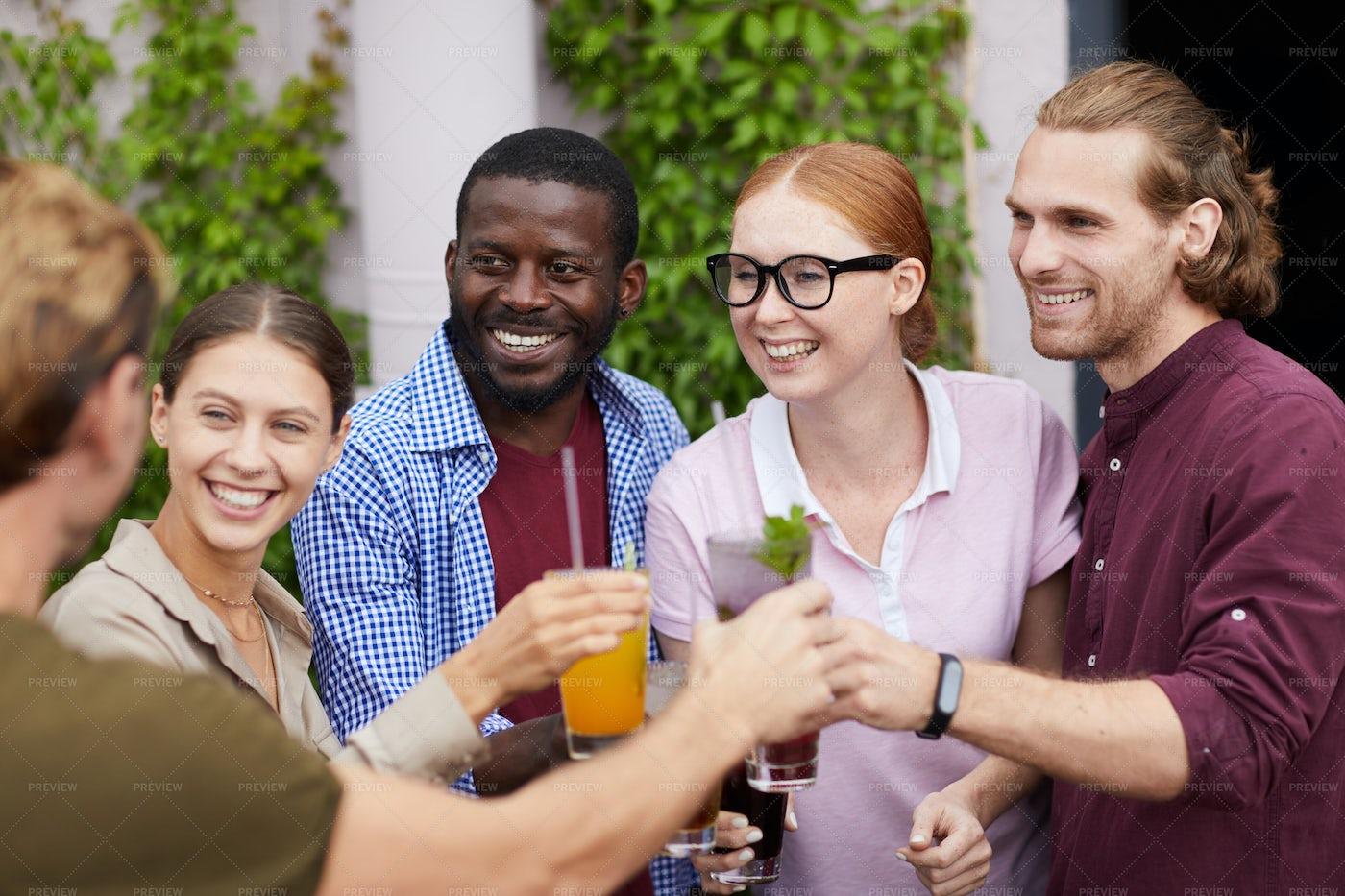 Friends Enjoying Drinks At Party: Stock Photos