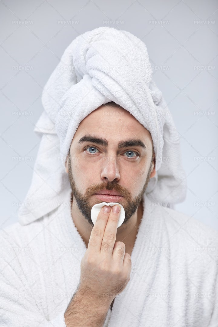 Caucasian Man Using Cotton Pad: Stock Photos