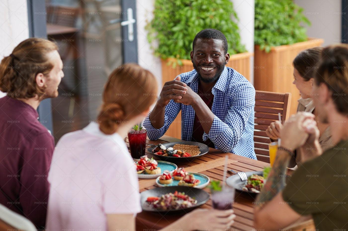 Diverse Group Of Friends Enjoying...: Stock Photos