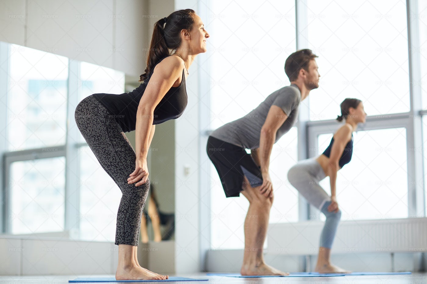 Yoga Students Practicing Back...: Stock Photos