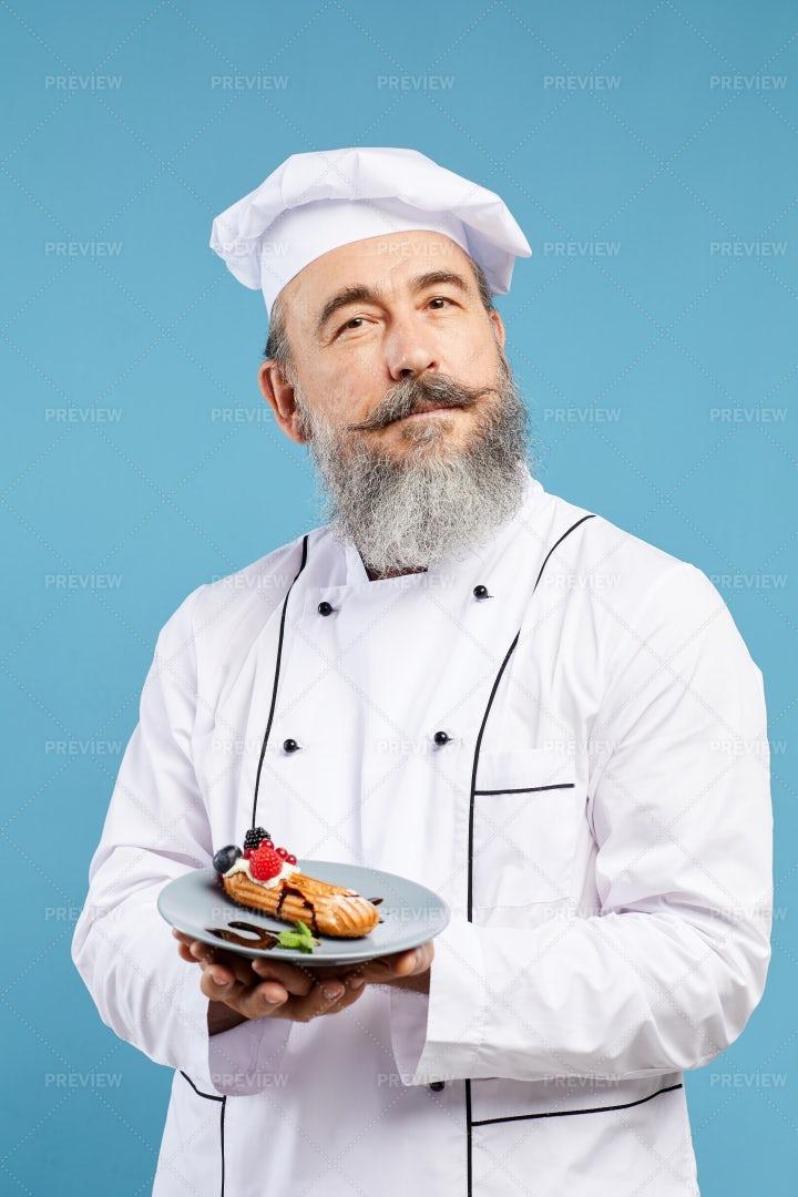 Bearded Chef Holding Dessert: Stock Photos
