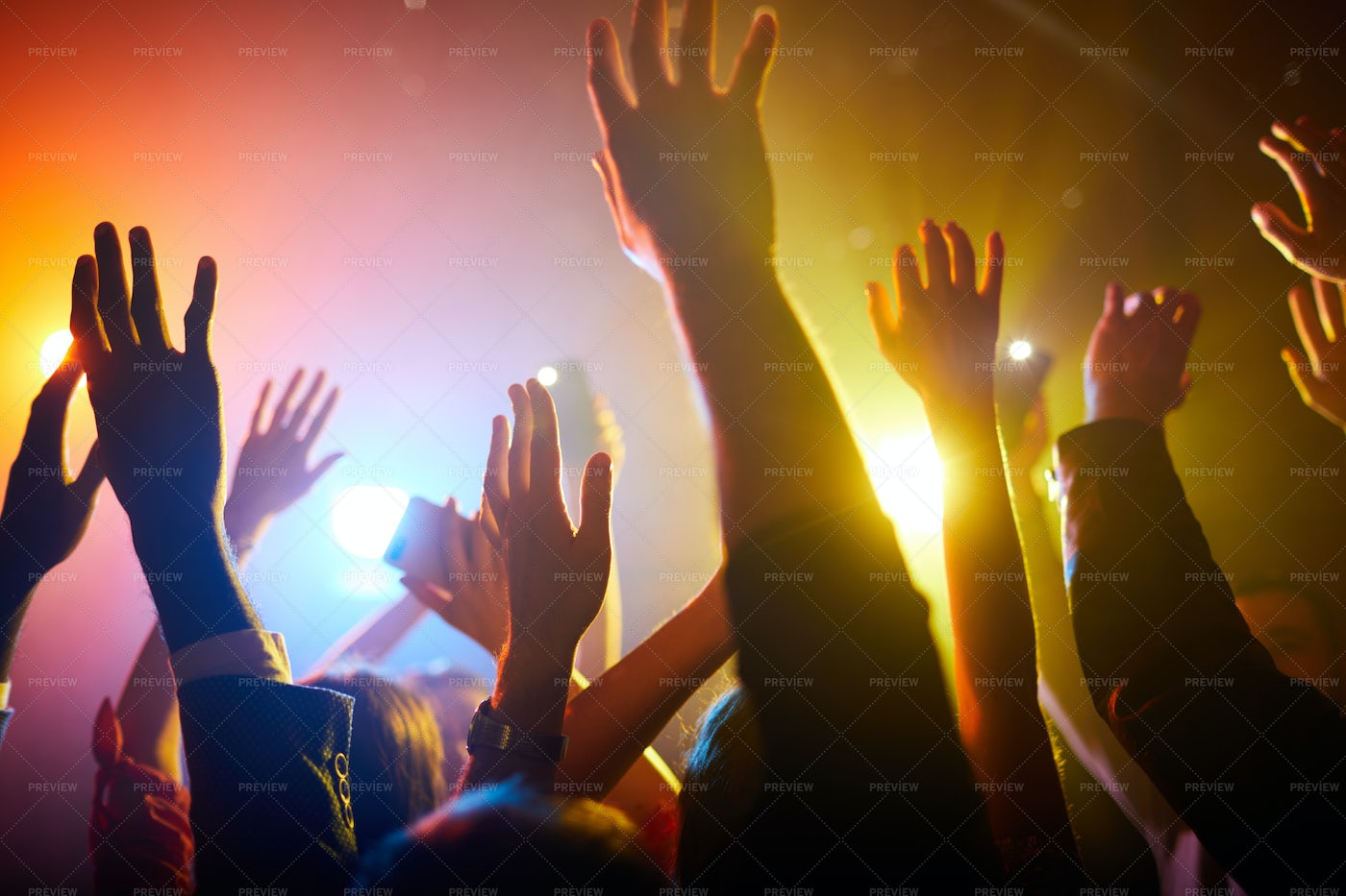 Waving Hands In Air During...: Stock Photos