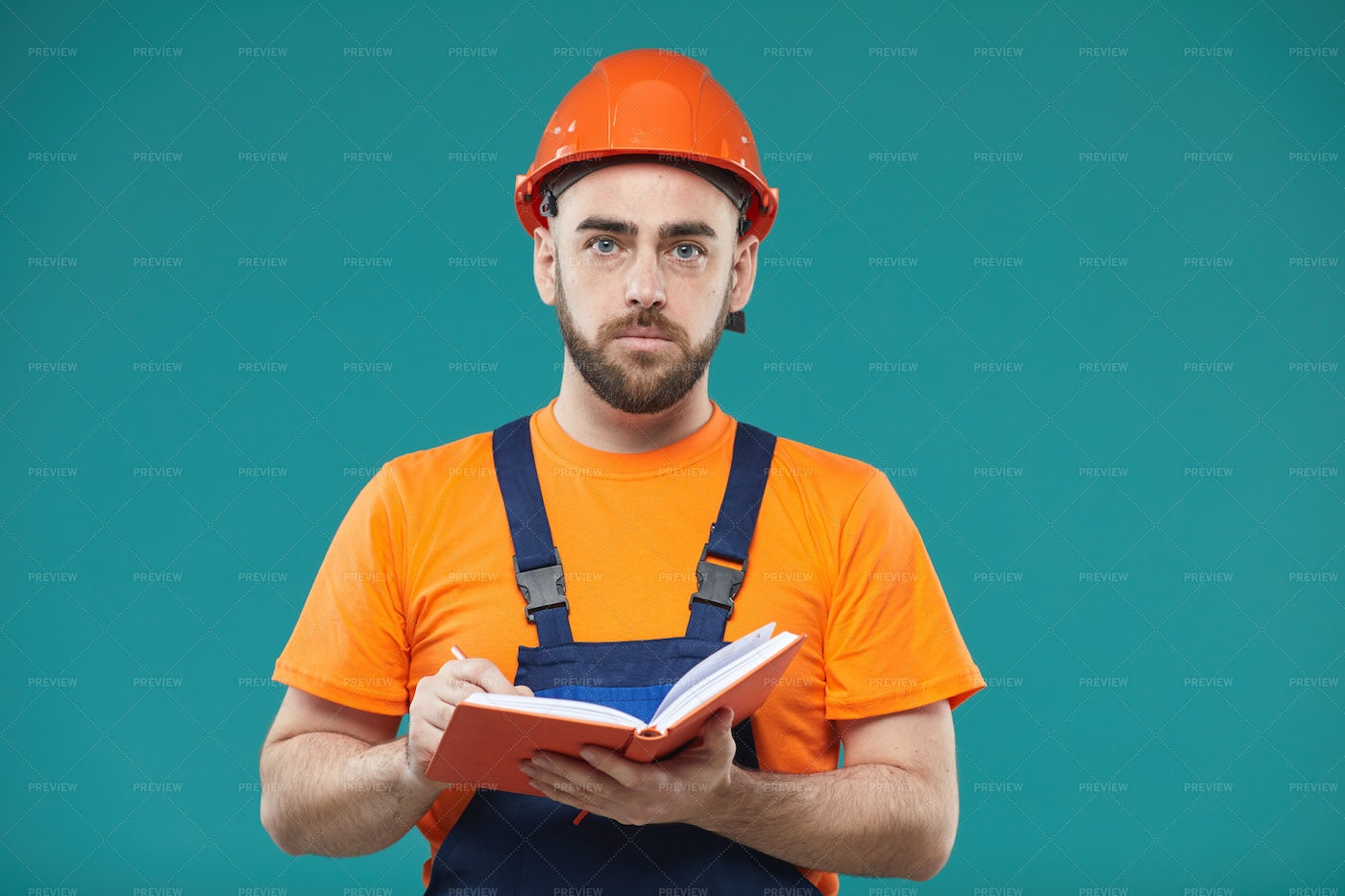 Professional Engineer Making Notes: Stock Photos