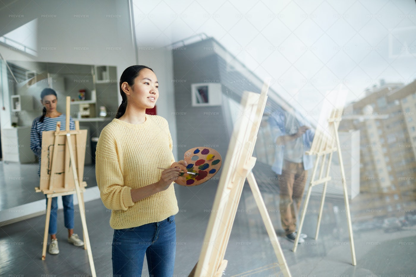 Girl In Front Of Easel: Stock Photos