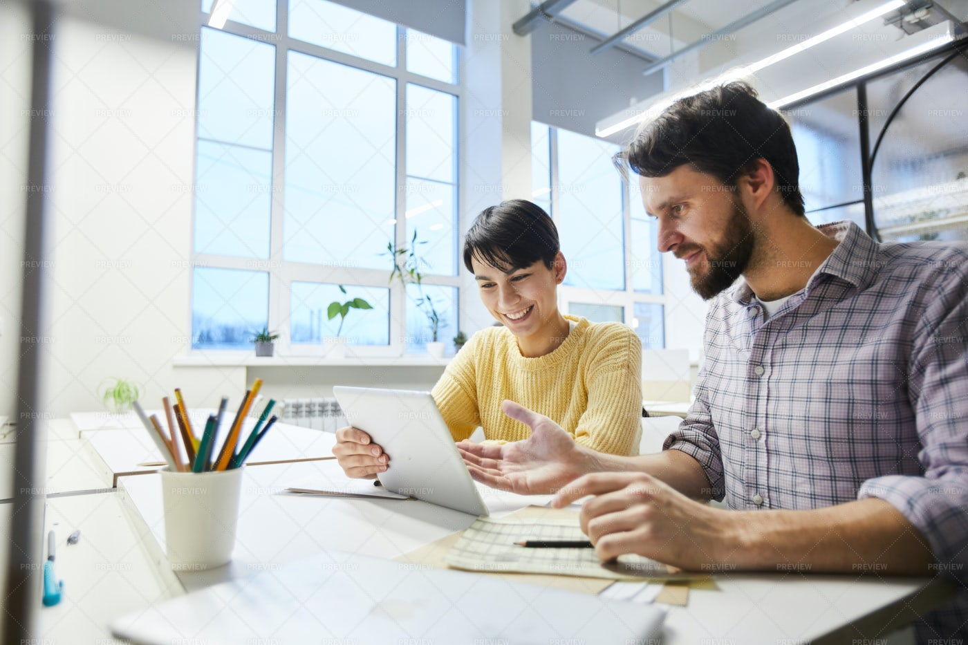 Positive Colleagues Discussing...: Stock Photos