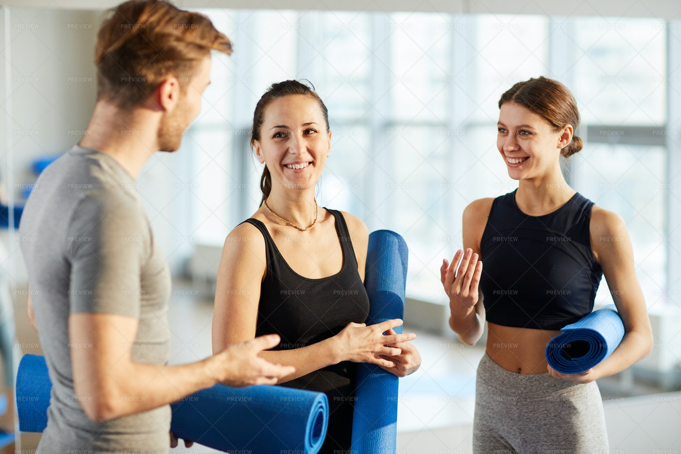 Yoga Students Discussing New...: Stock Photos