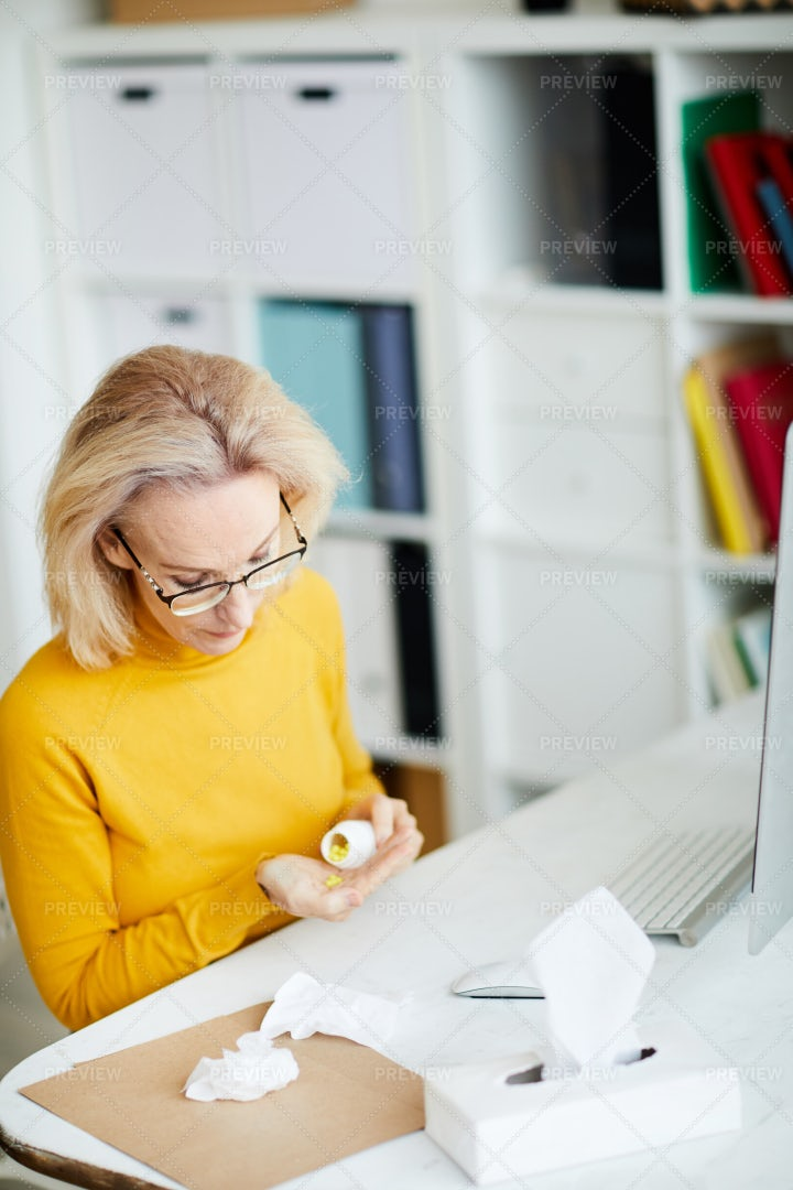 Woman Taking Pills At Workplace: Stock Photos