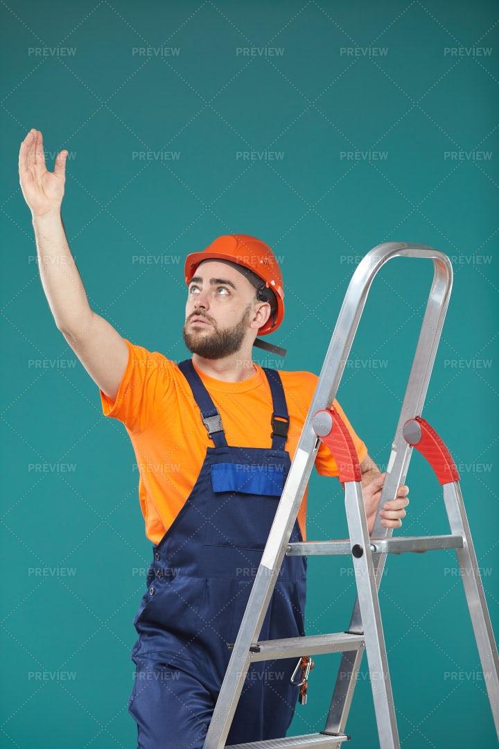 Electriciasn Working Standing On...: Stock Photos