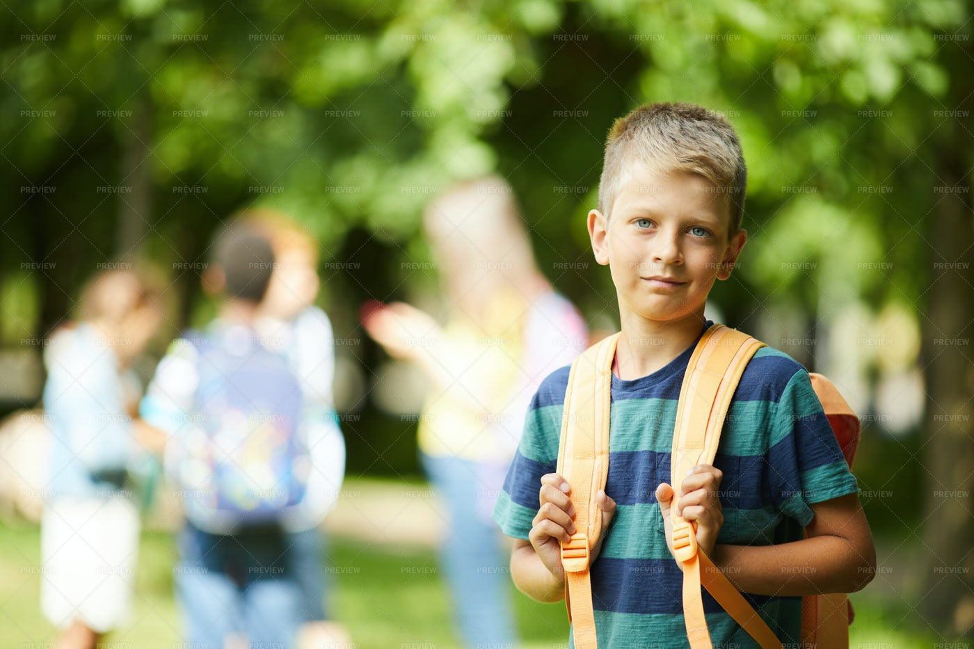 Schoolboy With Orange Backpack: Stock Photos