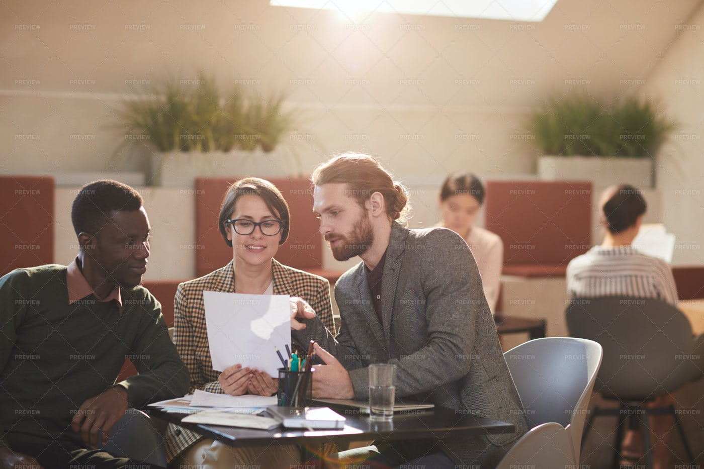 Business Meeting In Cafe: Stock Photos