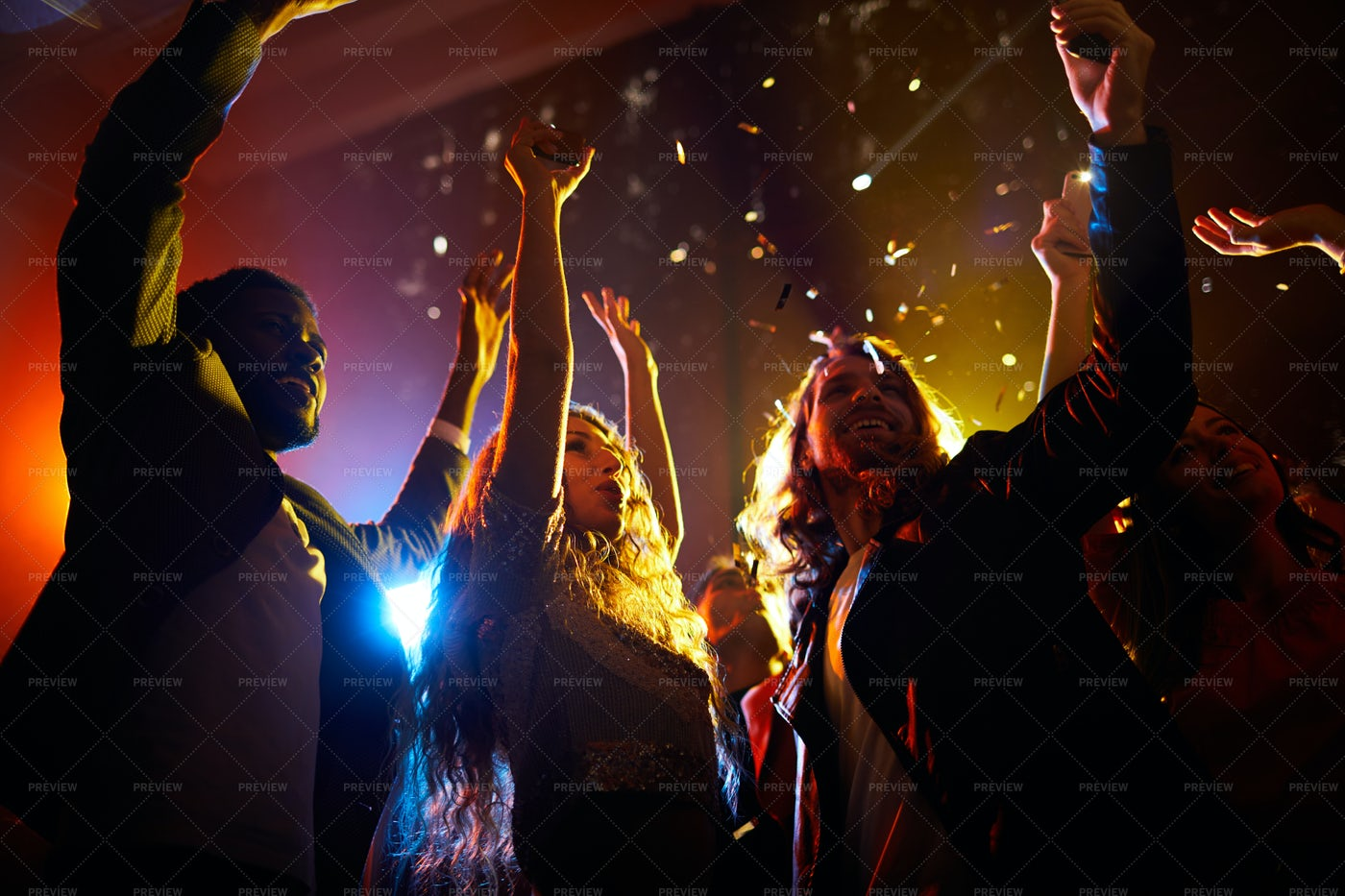 Excited People Dancing At Concert...: Stock Photos