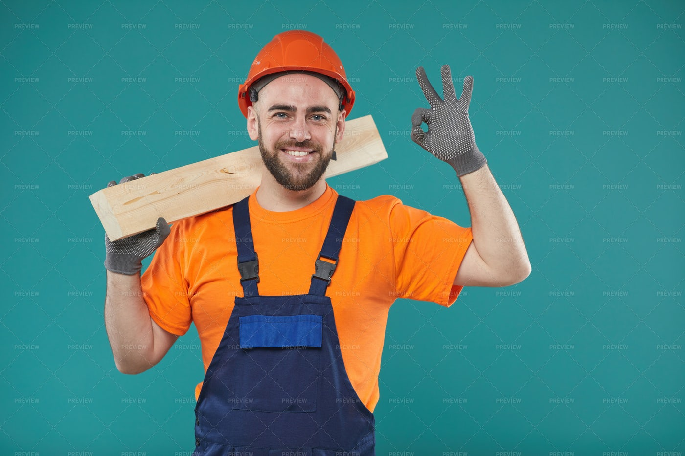 Happy Carpenter With Wooden Plank: Stock Photos