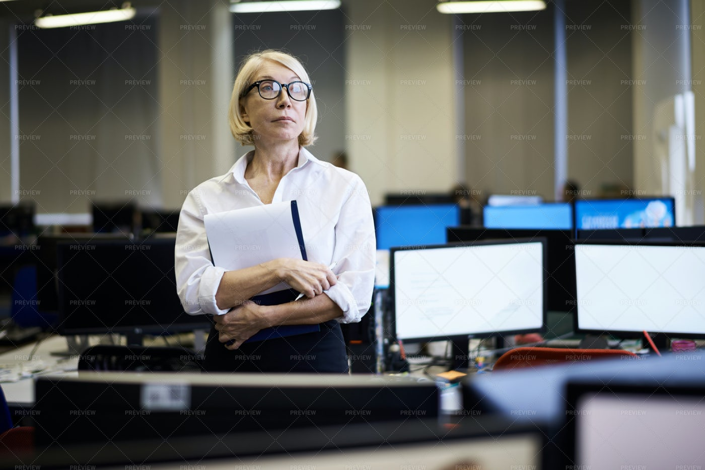 Mature Business Manager In Office: Stock Photos