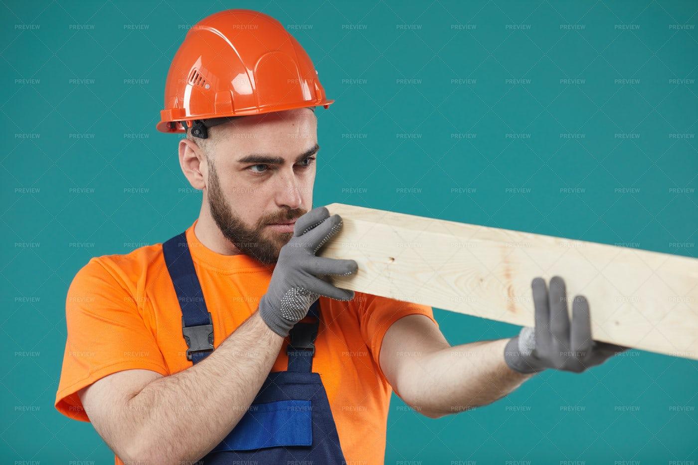 Carpenter Checking Wooden Plank...: Stock Photos