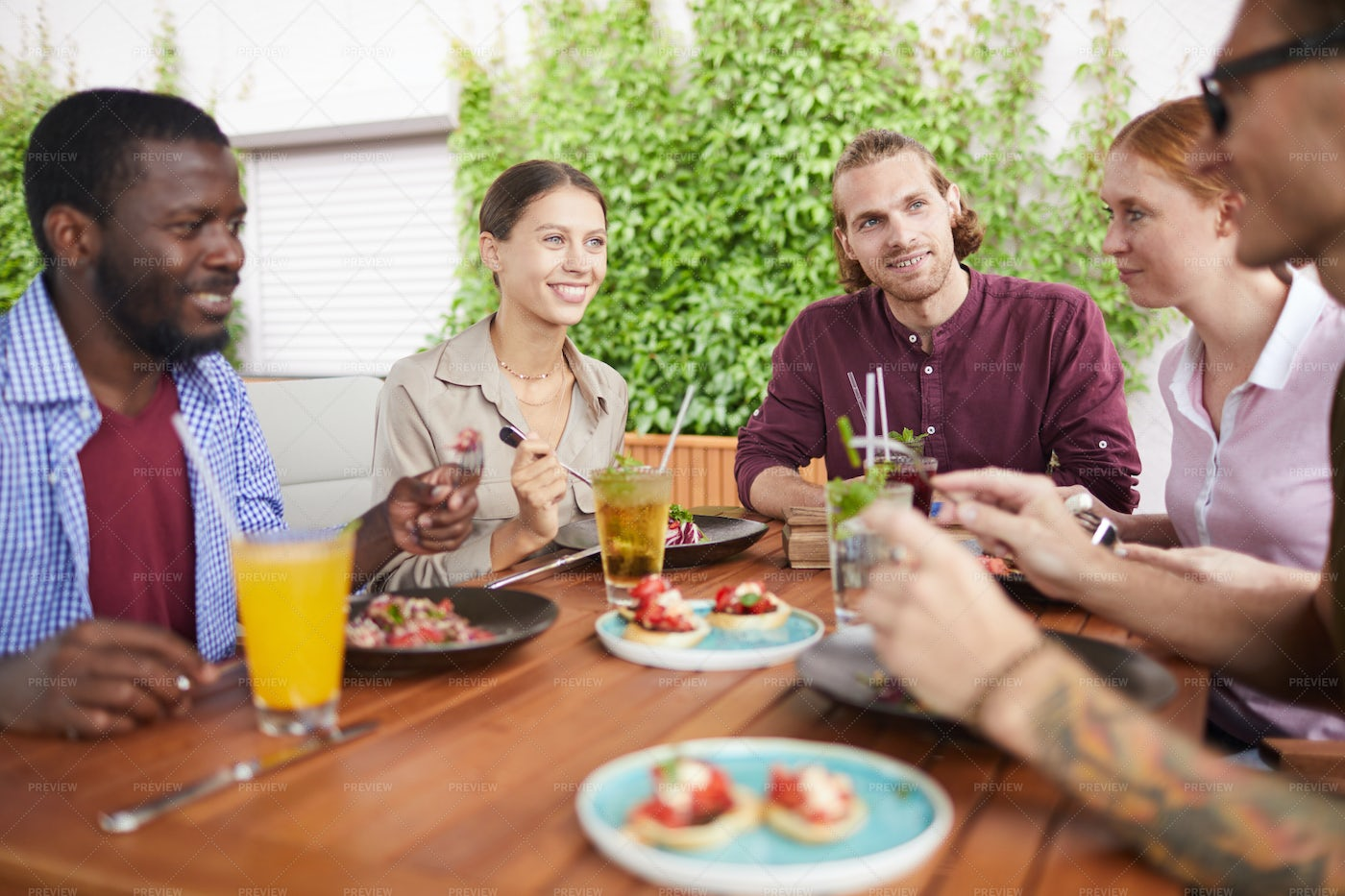 Friends Enjoying Lunch In Cafe: Stock Photos